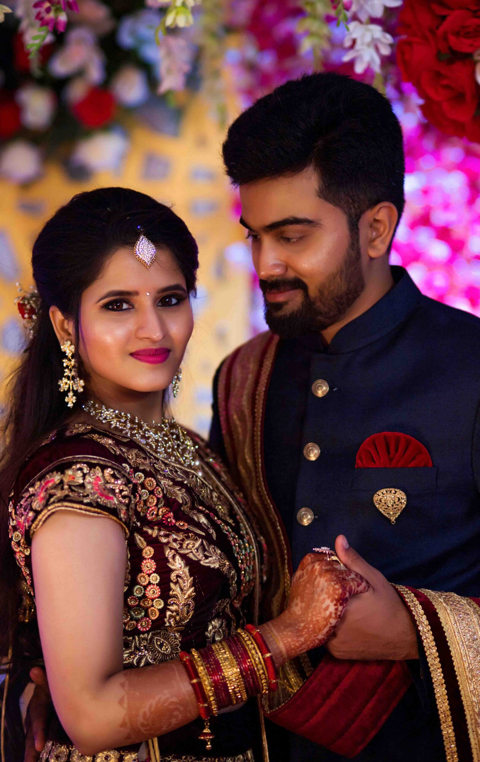 couple pose with lehanga
