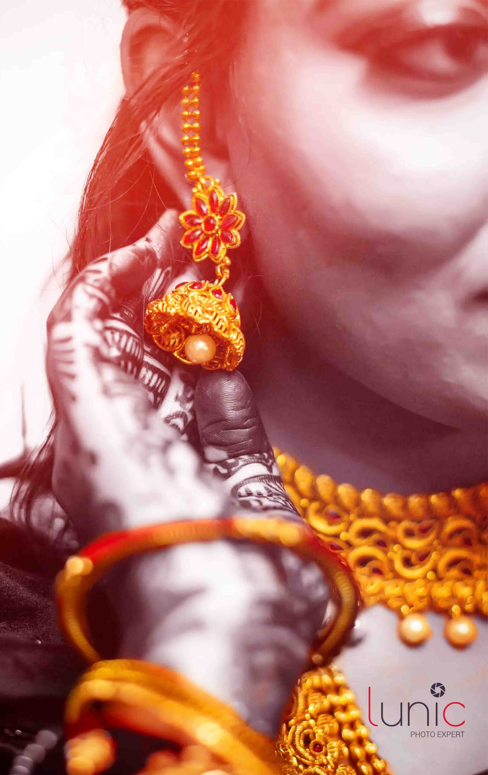 bride holding earings picture