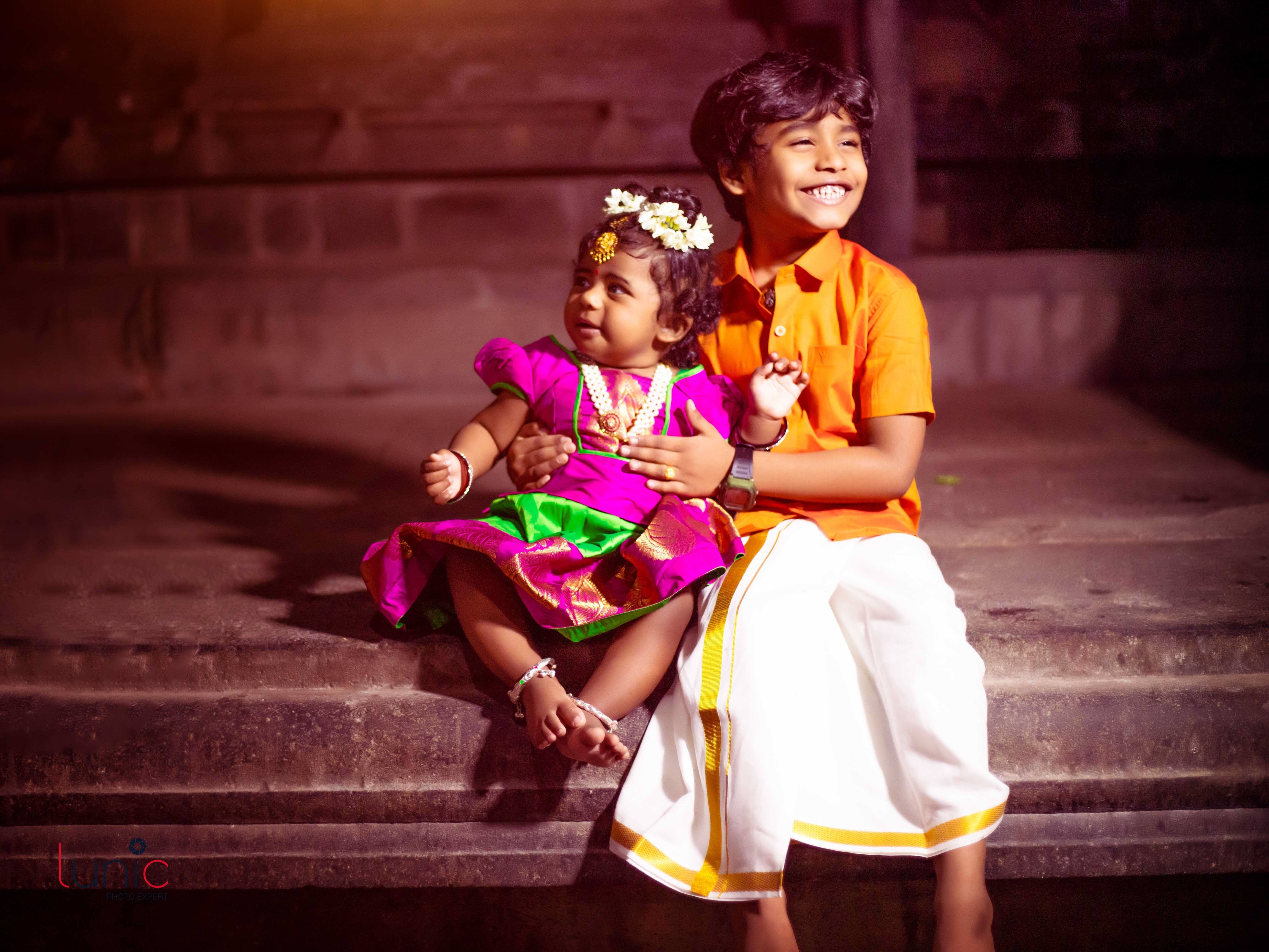 sweet siblings smile pose for traditional photography
