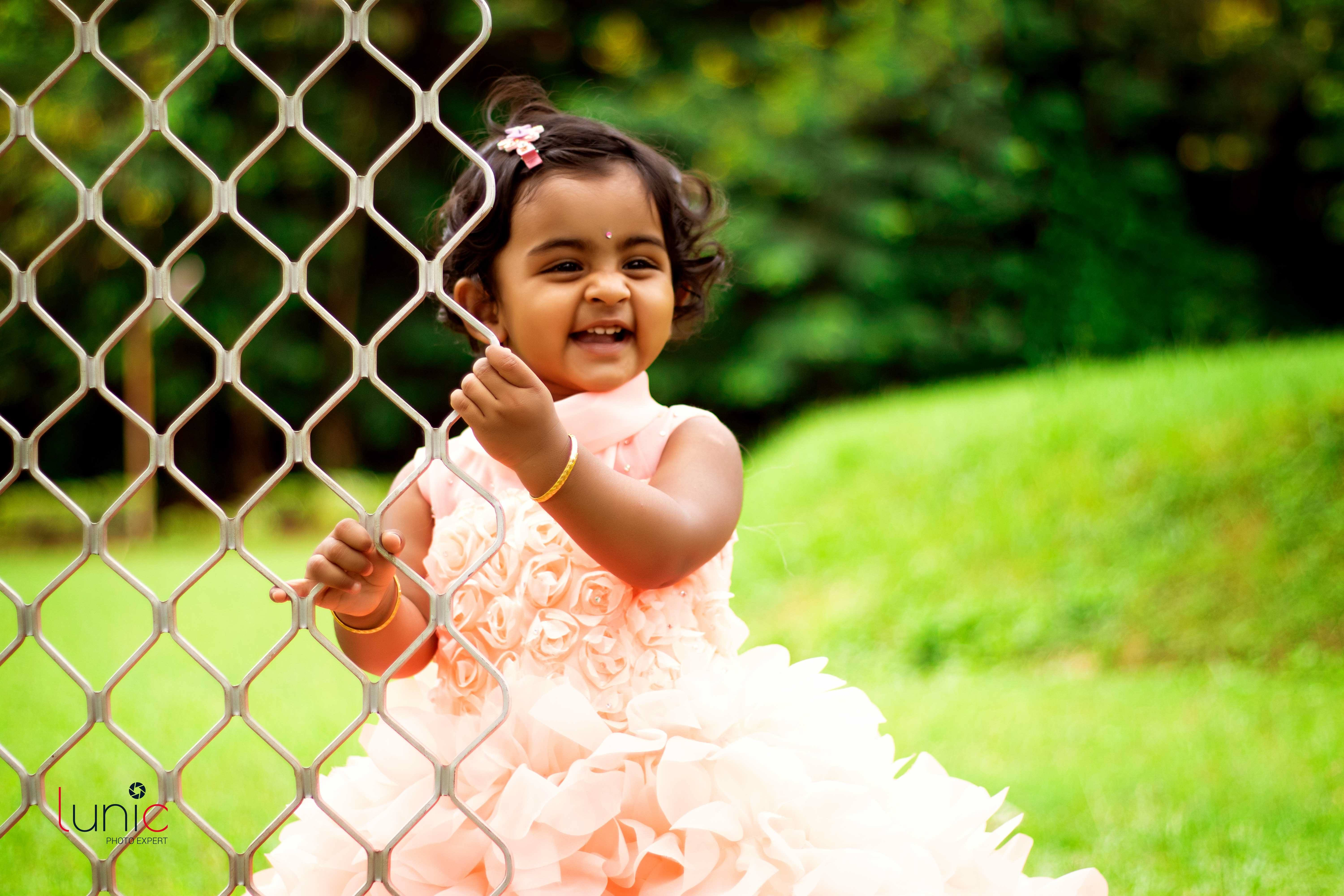cute baby pose with pink dress