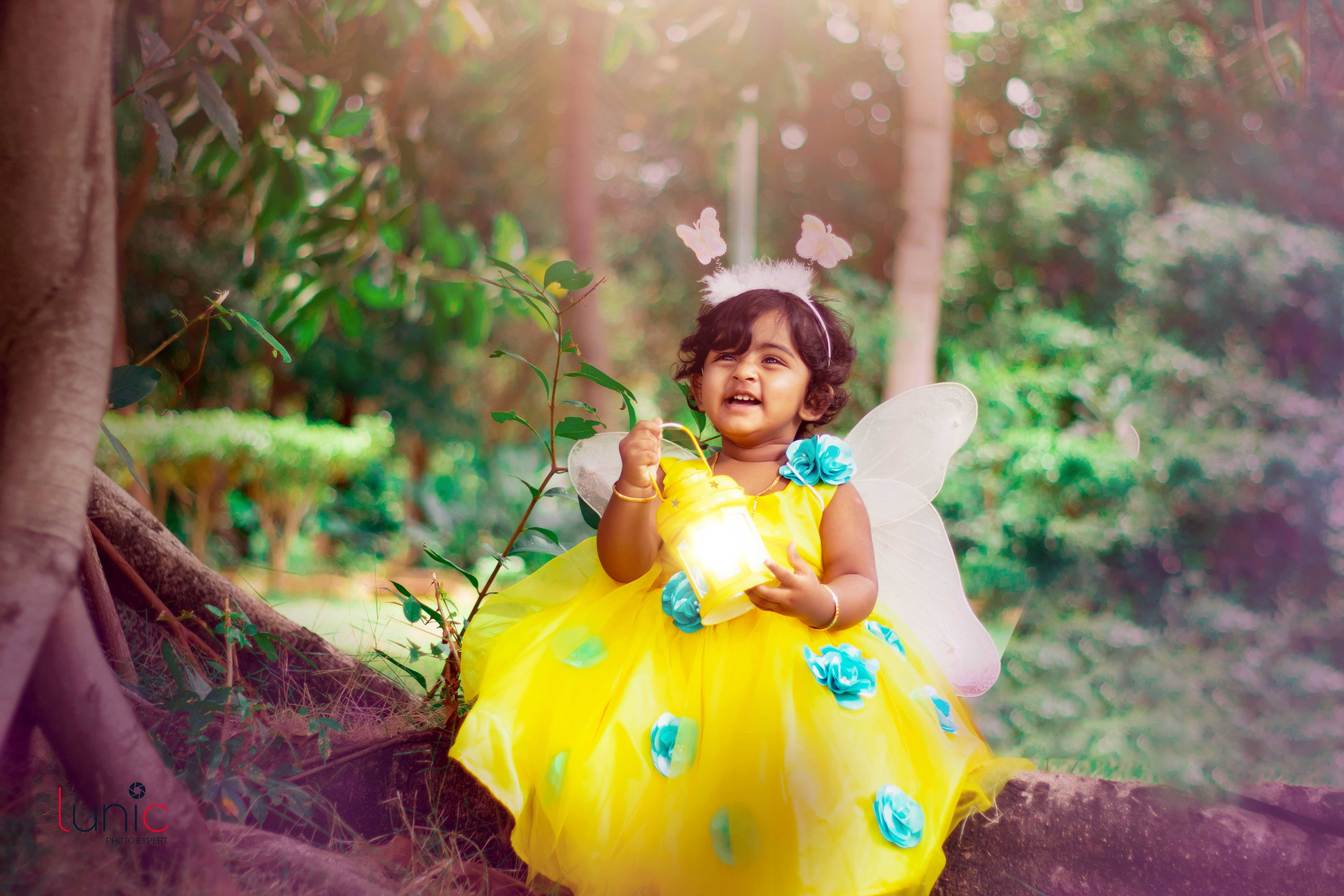 Baby in yellow dress