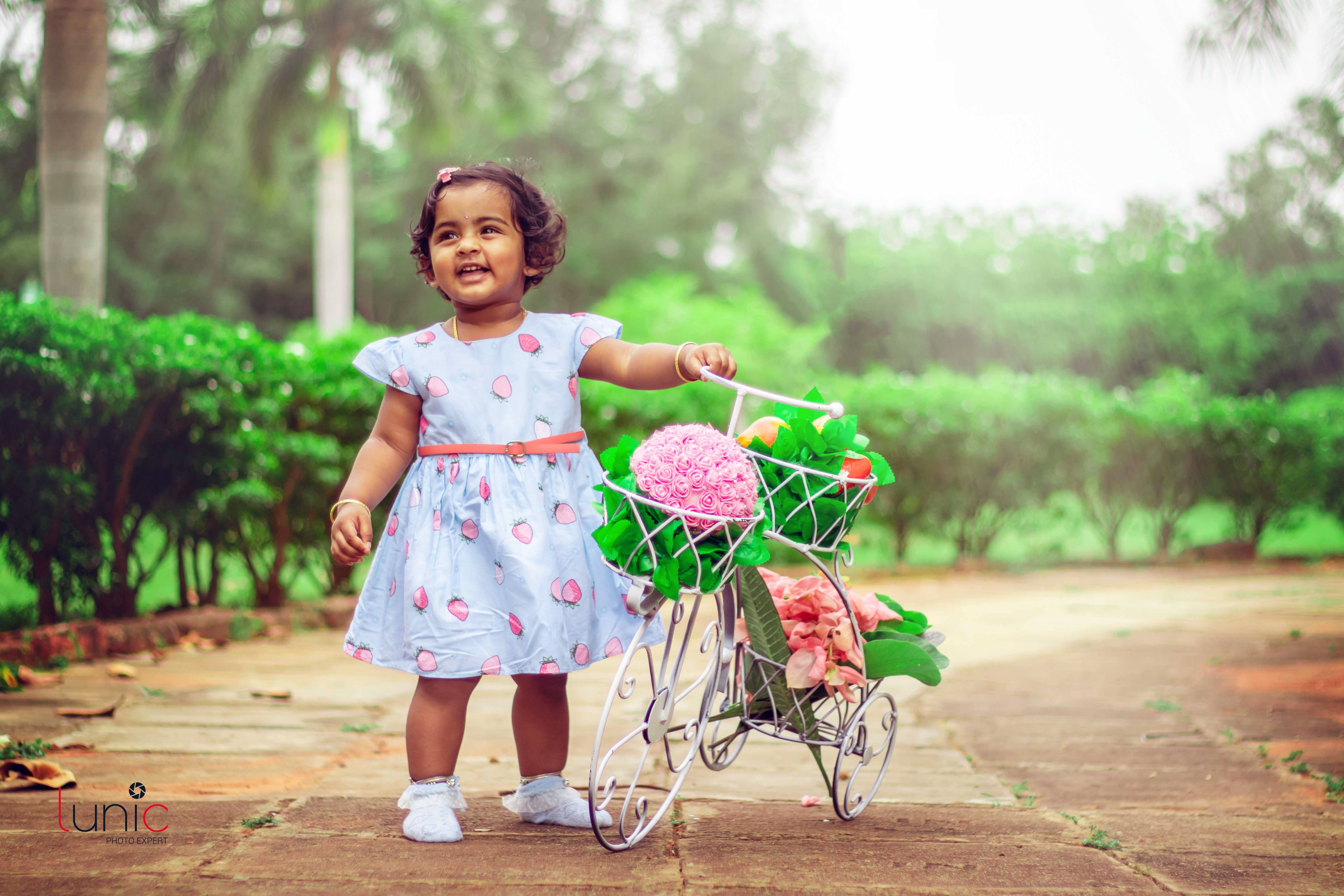 baby with bicycle photography