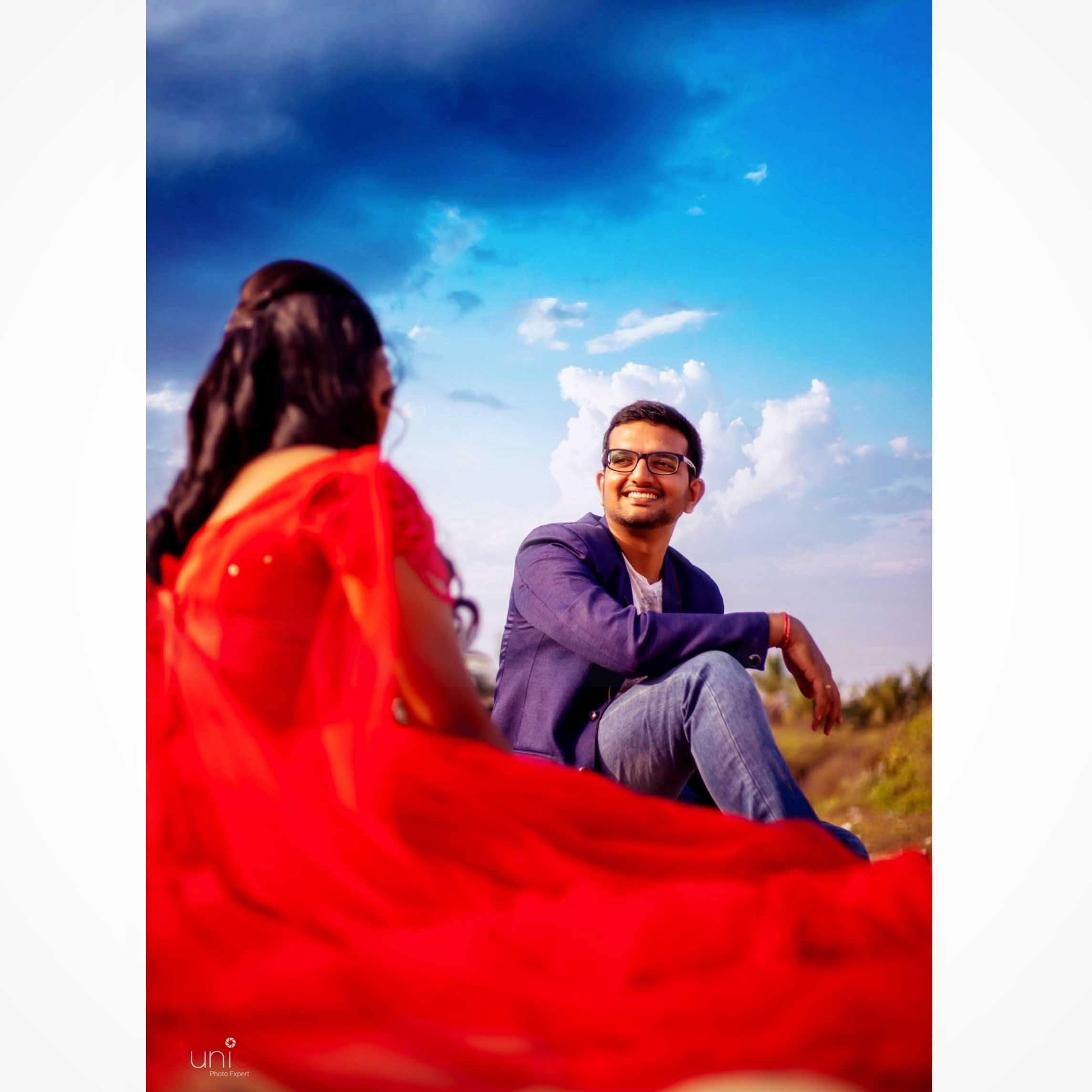 beautiful couple sitting at park during outdoor photography