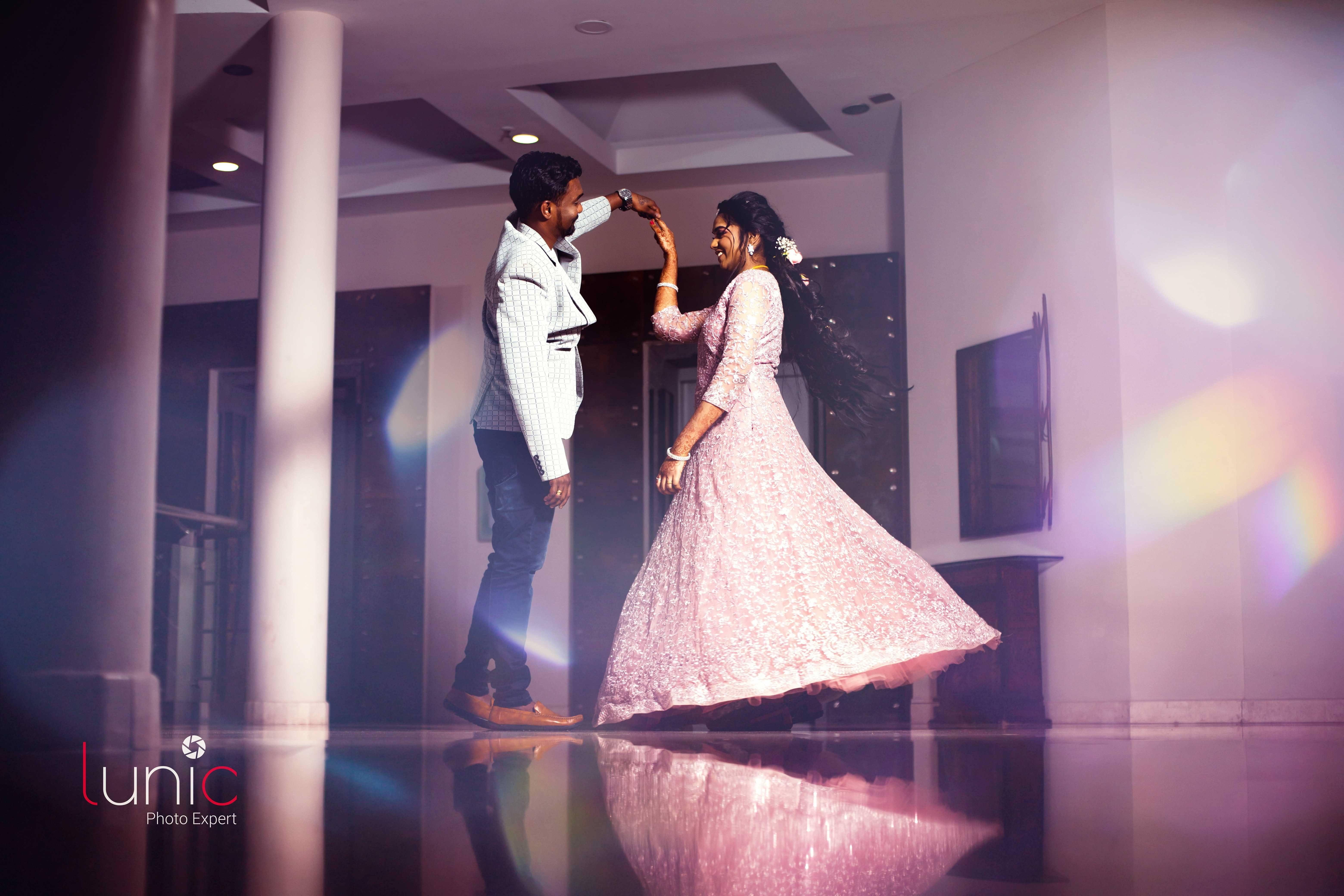 couple dancing pose for wedding lehanga